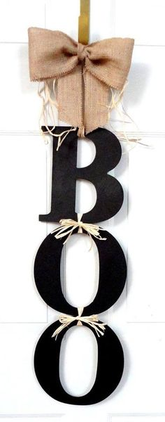 "#DIY #Halloween #decor - Letters tied together to spell ""BOO."" We love another pinners suggestion to add googly eyes for a little more spook factor."