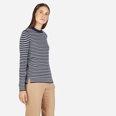 Inspired by a sailor's sweater, this Breton-striped crewneck is made from tightly-woven extra fine merino and comes finished with a split hem and discrete shoulder buttons. Fend off the sea spray—or just cold winds.