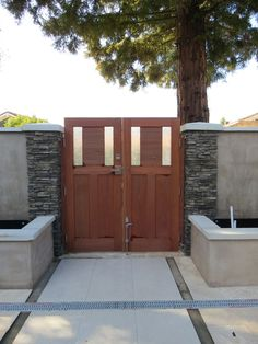Interior View of double entry gate with stainless steel modern hardware