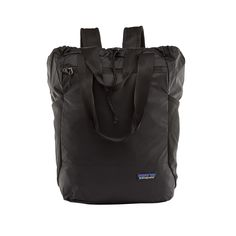 Ultralight Black Hole Tote Pack backpack in black Patagonia brand. This versatile bag is lightweight, durable and can be carried by hand, over the Sac A Dos Patagonia, Patagonia Brand, Patagonia Travel, Nylons, Travel Backpack, Fashion Backpack, Nike Sb, Travel, Logo Branding