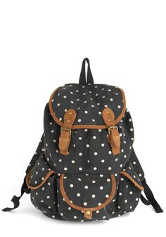 Destination Hot Spot Backpack (ModCloth, $74.99)    DETAILS:  Self: 75% Polyester, 25% Cotton. Lining: 100% Polyester.  Measures 17 inches in height, 15 inches in length, 7 inches in width. Shoulder straps are adjustable and measures 30.5 inches in length when fully extended.  Snap and drawstring closure. Three exterior pockets with snap closure. One exterior pocket with zipper closure. Two interior open pockets.  Imported