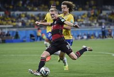 This photo shows the German Soccer player Andre Schuerrle scoring his seventh goal.