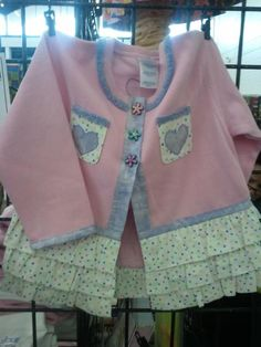Cute for a little girl,  sweat shirt cut open with cute ruffles sewn at the waist.