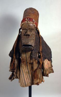Africa | Monkey mask from the Dan people of Liberia | Wood, country cloth, cowrie shells, basketry