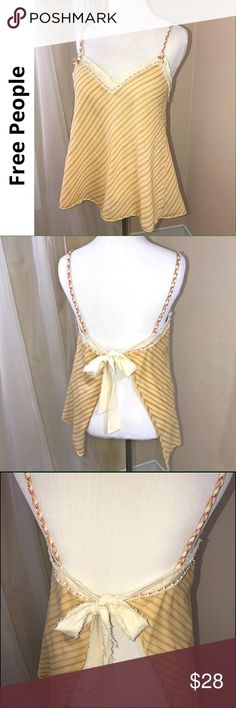 """FREE PEOPLE open back striped cami top In a soft golden yellow striped 100% cotton fabric, this bo-ho/vintage looking cute top has a fun open back! Raw edge cream gauzy trim fabric along the top that ties in back.  Bead trim embellishment & fun braided straps add to this fun & flirty, loose fit, flare design. Tad of red, tan colors also grace this top. Great condition. Approx measurements laying flat: armpit to armpit:15""""/armpit to hem:17"""" Free People Tops Camisoles"""