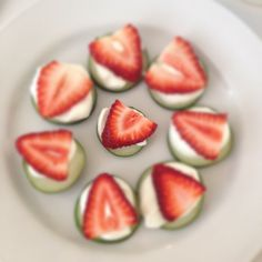 Strawberries over Greek yogurt and cucumbers!!! Perfect snack <3 http://ToneItUp.com #self #drop10