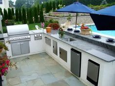 outdoor kitchen counter with soffit above with lights - google