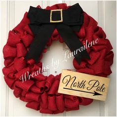 A personal favorite from my Etsy shop https://www.etsy.com/listing/260191321/red-burlap-north-pole-christmas-wreath