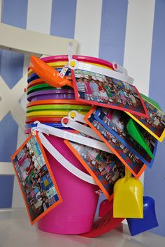 Last day of school buckets for classmates...print off a class photo and fill with treats and summer toys