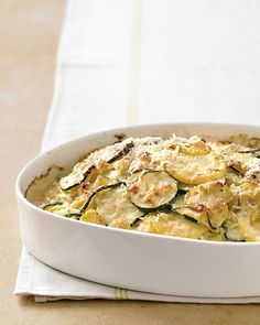 Zucchini and Yellow Squash Gratin. Made this for Easter dinner with the fam and got quite a few compliments. Pretty easy to make, chopping the veggies is the most time-consuming part. Doubled the recipe to serve 8 and it worked pretty well. Will probably use less shallots next time, it was a little too oniony for my taste.