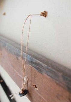 Upholstery needle and twine. Clever way to keep the tuft in a upholstered headboard. Diy Tufted Headboard, Diy Headboards, Diy Home Crafts, Diy Home Decor, Master Bedroom Makeover, How To Make Bed, Diy Furniture, Bedroom Decor, Diamond