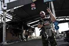 """An armed pro-Russian separatist after the battle for """"Marinovka"""" checkpoint near russian boarder."""