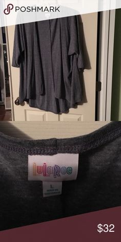 Heathered Blue Lindsay EUC. Worn twice and washed per LuLaRoe instructions. It's a dark blue that almost looks grey. Large fits size 20-22 LuLaRoe Tops