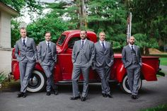 Groom & Groomsmen in Front of Vintage Red Truck | Photography: Judith Rae. Read More:  http://www.insideweddings.com/weddings/whimsical-vintage-garden-wedding-with-rustic-details/826/