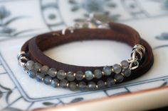 Labradorite triple wrap leather bracelet w/silver lobster clasp. Available in brown or black leather. Made of sterling silver, silver plate, and 14kt gold fill components