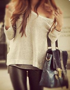 Off the shoulder sweater with leather leggings.