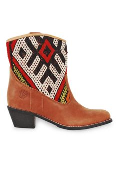 Handmade kilim and leather ankle boots for women. A combination of original vintage kilim rugs and premium leather.