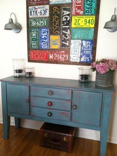 Our homemade license plate art in our dining room and buffet table with water valve knobs