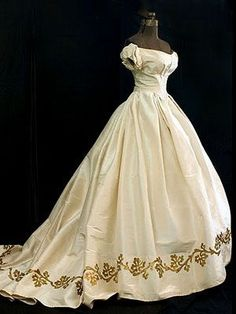 Silk moiré ballgown with metallic gold appliquéd hem border, c.1860.