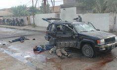 Dead jihadists and U.S. Marines taking cover during fierce fighting in Fallujah, Iraq