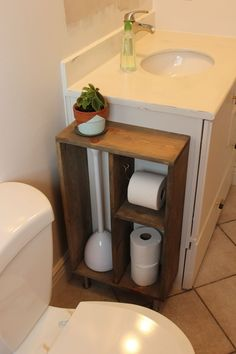 This is a tutorial for building your own custom storage shelving to attach to the side of your bathroom vanity. The idea is to contain toilet paper and oth