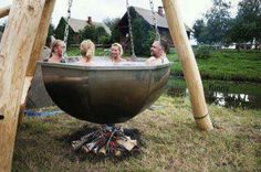 love this! tripod hot tub over wood fire