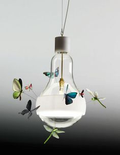 Lovely 'collage' lamp by the fine lighting artist Ingo Maurer