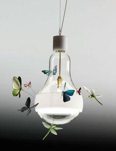 Lovely 'collage' lamp by the fine lighting artist Ingo Maurer