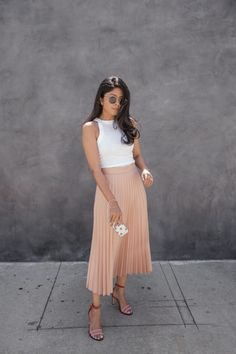 Strip the pleated skirt trend back to basics and combine a classic blush pink skirt with a white crop top to steal Sheryl Luke's awesome and feminine style. Top: Cotton On, Skirt: Zara, Shoes: Dear Frances.