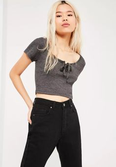 """Good things come in small packages. Shop our Missguided petite range, for babes 5""""3 and under.  Nail the casual style in this cute grey ribbed crop top with lace up deets."""