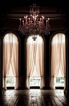 Tall windows with pretty drapery