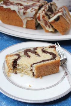 Marble loaf cake recipe- Tea time cake. Buttery soft vanilla cake with chocolate swirls! Theloveofcakes.com