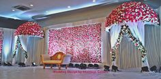 The floral wall with floral umbrella, works well! the design has 2 wings of floral wall on either side and its not been captured in this photo. always white makes it neat, and a perfect corner for your couple shots. Reception Stage Decor, Wedding Stage Design, Wedding Reception Backdrop, Desi Wedding Decor, Wedding Hall Decorations, Backdrop Decorations, Engagement Stage Decoration, Marriage Decoration, Floral Umbrellas