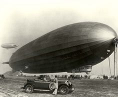 Graf Zeppelin moored at North Island, San Diego NAS, during 1929 global tour.  Note Goodyear blimp in background.