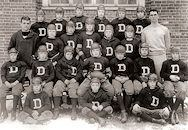 On the team - the Dexter boys school football team in Brookline, Massachusetts, featuring Jack Kennedy at about age ten (seated on ground, front right) and older brother Joe (row behind, third from left)