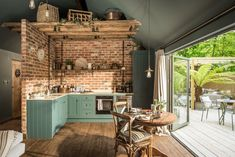 Sanctuary – Hampshire, UK rustic cottage kitchen with huge bi-fold doorsSanctuary (disambiguation) A sanctuary is a social institution. Sanctuary or The Sanctuary or Sanctuaries may also refer to: Cottage Kitchens, Home Kitchens, Kitchen Dining, Kitchen Decor, Kitchen Rustic, Self Catering Cottages, House Of Turquoise, Rustic Cottage, Forest Cottage