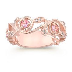 Round Pink Sapphire and Diamond Ring in Rose Gold. This gorgeous ring crafted in quality 14 karat rose gold features four round pink sapphires, at approximately .43 carat TW, and 18 round diamonds at approximately .08 carat TW.  This uniquely feminine ring has a total gem weight of approximately .51 carat. #ShaneCoLBD