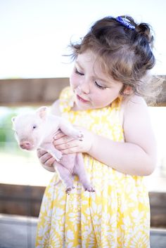 This wee piglet isn't more than a few weeks old. In a few short months, this little girl will no longer be able to lift it! This Little Girl, This Little Piggy, Little Pigs, Animals For Kids, Baby Animals, Cute Animals, Kind Photo, Mini Pigs, Baby Pigs
