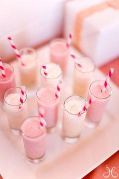 strawberry milkshakes with red striped straws