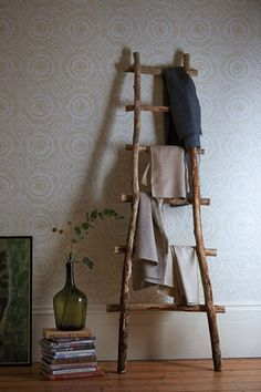Subtle yet stylish wallpaper  ...also like the ladder and green jug.