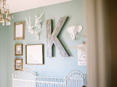 Glam gallery wall for a little boy's room. love the giant k!