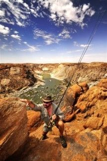 Catfish Joe Fishing - Northern Cape. Experience unique fishing holidays in remote and breathtaking fishing hotspots on the lower Orange River – white water and slow water rafting combined with fly fishing. Small outboard motors provided.