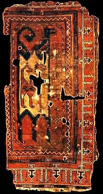 Fragment of a Seljuk Turkic, dragon motifs stylised rug, ca. 13th to 14th centuries.