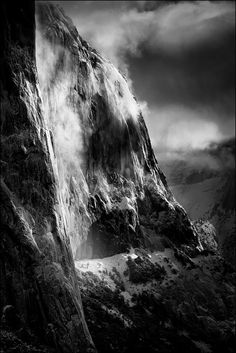 The Captain's Shroud; photograph by John Lambert. El Capitan shrouded in low cloud just after sunrise and following a clearing storm. Yosemite National Park, California