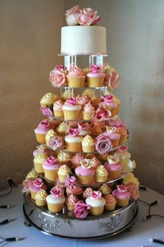 Cupcakes wedding cake. Will need to convert to shades of marine and maybe silver cupcake liners but LOVE the depth of this arrangement !