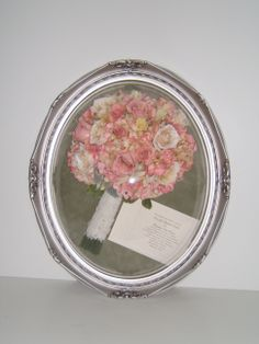 The Bride used the lace from her Mom's dress on the handle which we preserved in this antique silver oval bubble frame along with her invitation. (3d bubble) fafpreservation.com