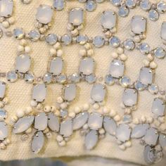 Bejeweled jacket sleeves with clusters of pale, moonstone-color stones #toryspring14 #nyfw