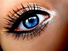 white shadow with dark black liner and mascara