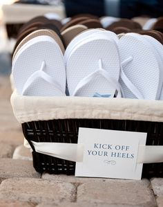 "Beach wedding idea or for any wedding theme. ""Kick off your heels"" basket filled with flip flops for the guests so they can be comfortable and dance the night away."