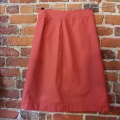 J Crew Women's SZ 2 pink skirt 1 imperfection J Crew Women's SZ 2 Apricot pink skirt (one teeny imperfection on back bottom of the skirt, a slight lighter mark.  Brand: J Crew Style: A Line Size Type: Regular Size: 2 Color: Pink / apricot Pattern: no Material: 100 % Cotton -- DRY CLEAN ONLY Occasion: Casual, Career, Fun, Party Lined: No Pockets: No Zipper: Yes, back enclosure Sheer: No Buttons: No Embellishments:  No Measurements: Waist: 28 inches Hips: approx. 38 inches Total Length: 25.5…